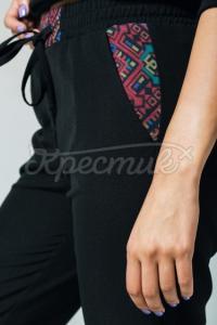 Жіночі брюки з декорованими кишенями чорні фото