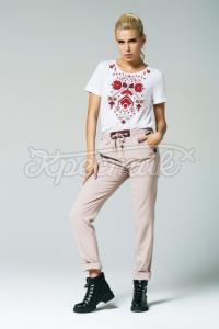 Жіночі штани з декорованими кишенями бежеві фото