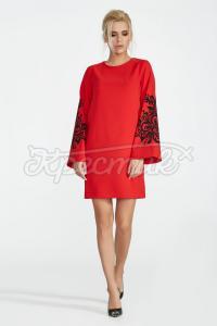 Червона сукня з орнаментом на рукавах фото