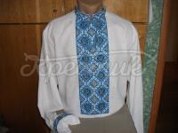 Вишита чоловіча сорочка на домотканому полотні. Вишита хрестиком чоловіча сорочка