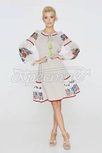 Ефектне плаття з декором на рукавах фото