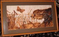 Вишита картина пантера і метелик