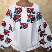 Вышитая женская блузка цветные калачики фото